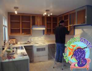 Richard hand restoring kitchen cabinets at our guesthouse in Sonoma Valley.