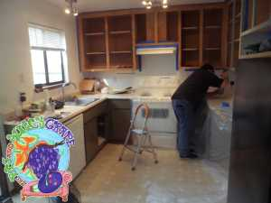 Richard hand-restoring kitchen cabinets at our Sonoma Valley guest house.