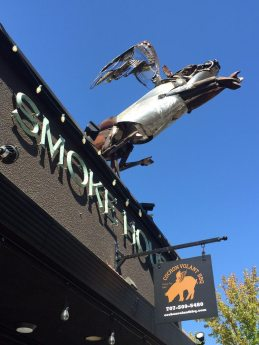 Cochon Volant metal sculpture atop restaurant. BBQ Smoke House just steps away from our wine country guesthouse The Big and Juicy Grape.