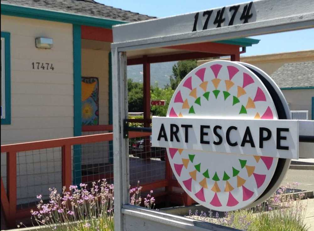 Street sign for Art Escape, a community gallery and art studio just steps away from our Sonoma Valley guest house.