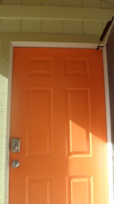 Look for the bright and cheery door.