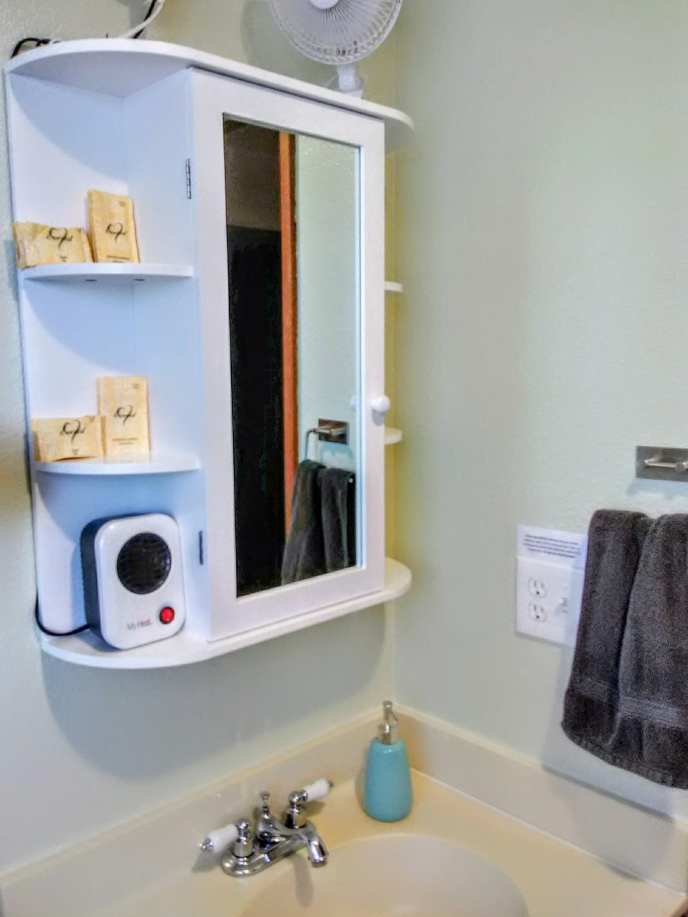 Medicine cabinet, bath fan, bath heater, bath sink.