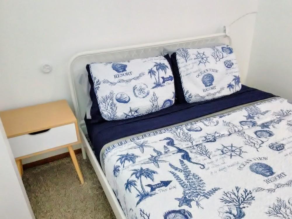 Queen Bed in Blue Room.